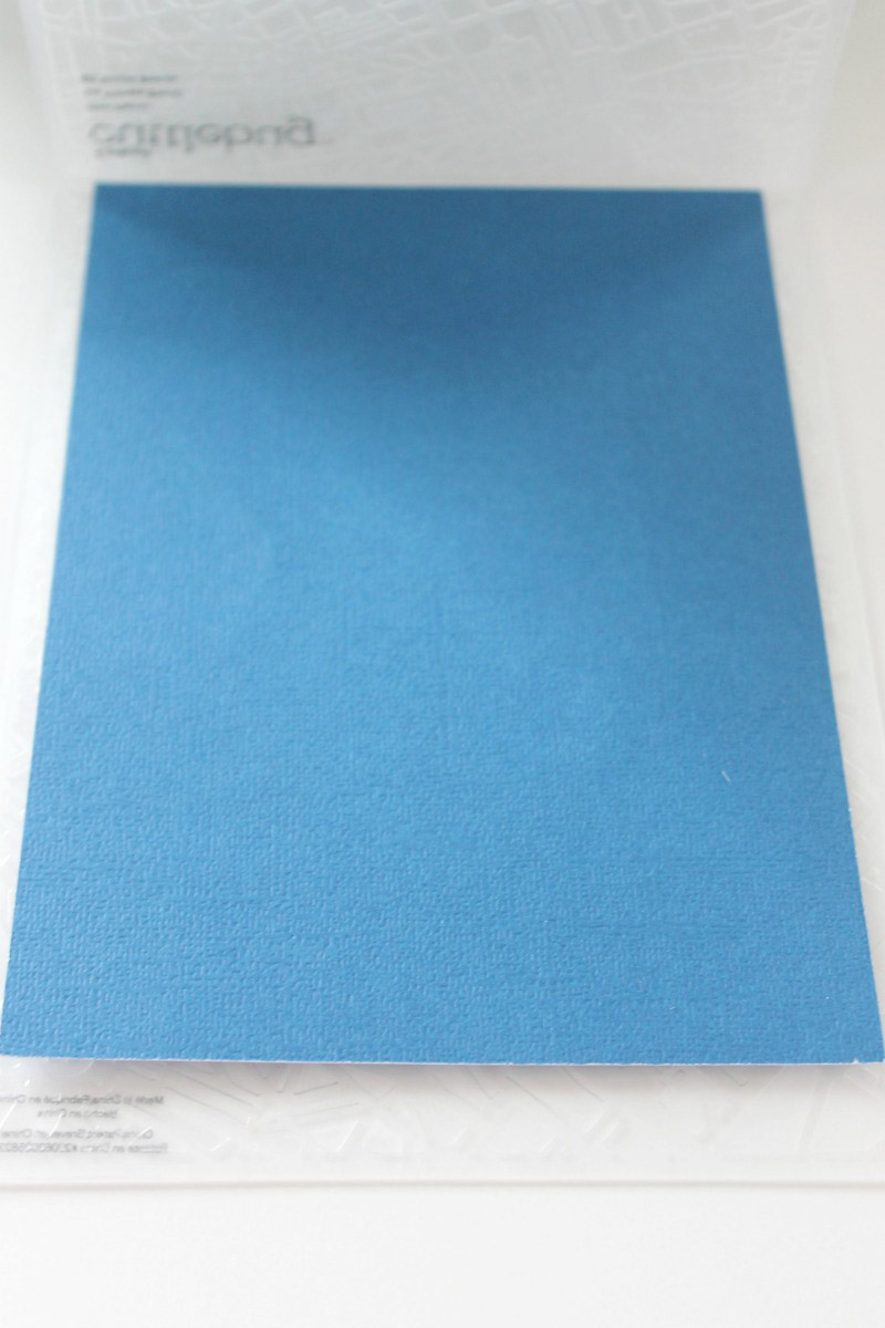 Put your material inside the embossing folder