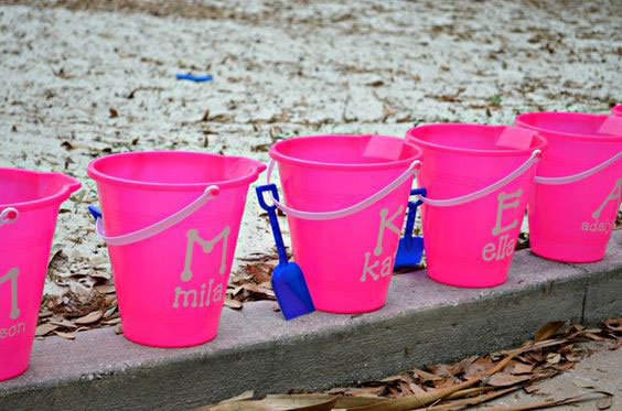Cute sand buckets can be customized using a Cricut