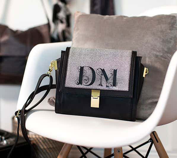 Give your bridesmaids purses bearing their initials