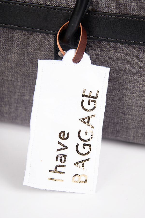 Tag with straps