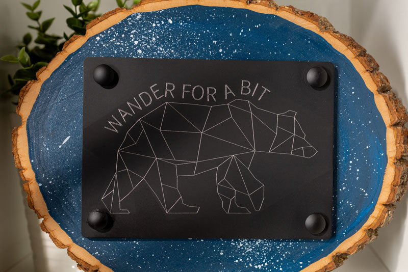 """Wander for a bit"" Cricut engraving project"