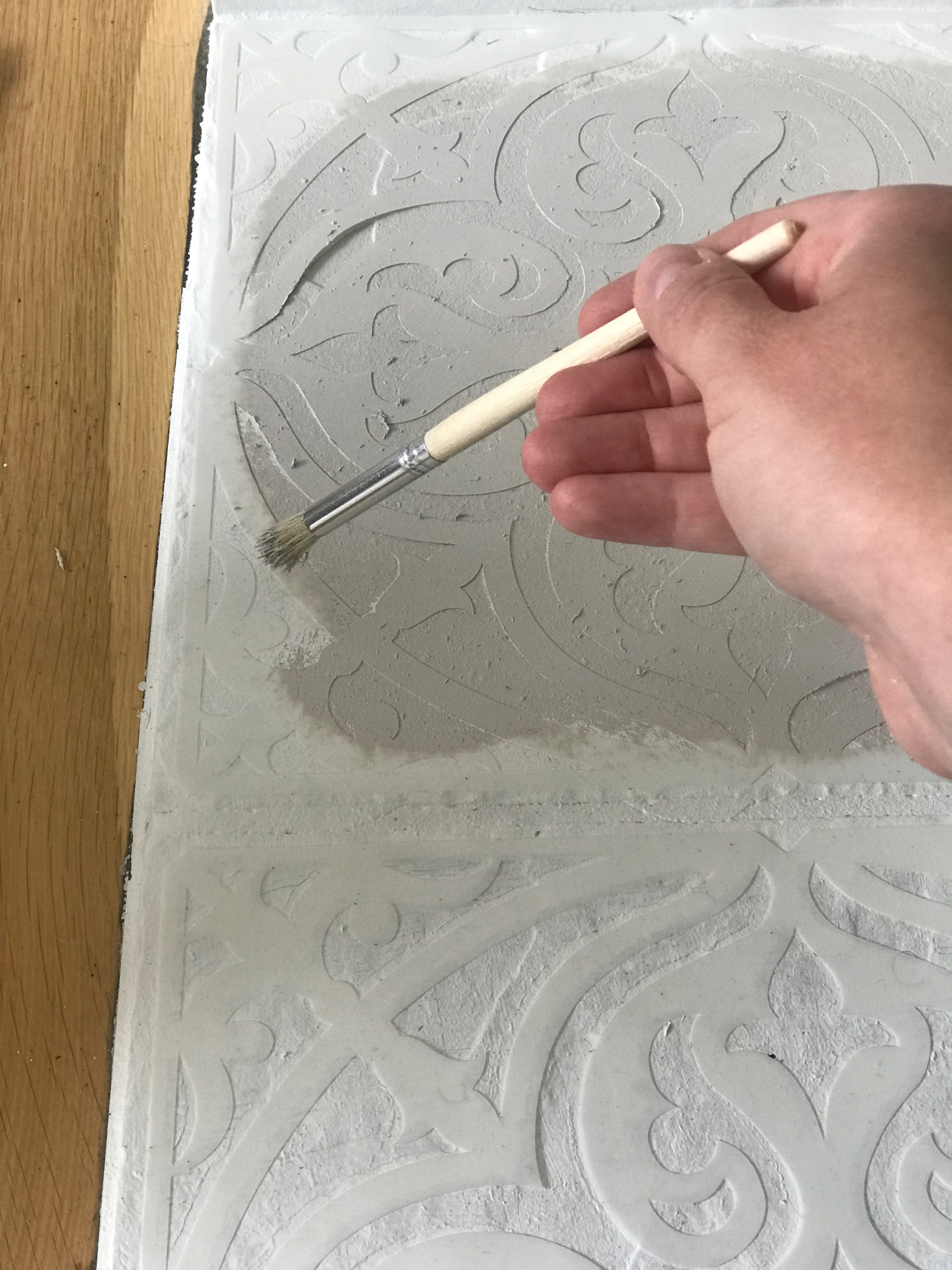 Painting a DIY custom stencil for a fireplace mantel
