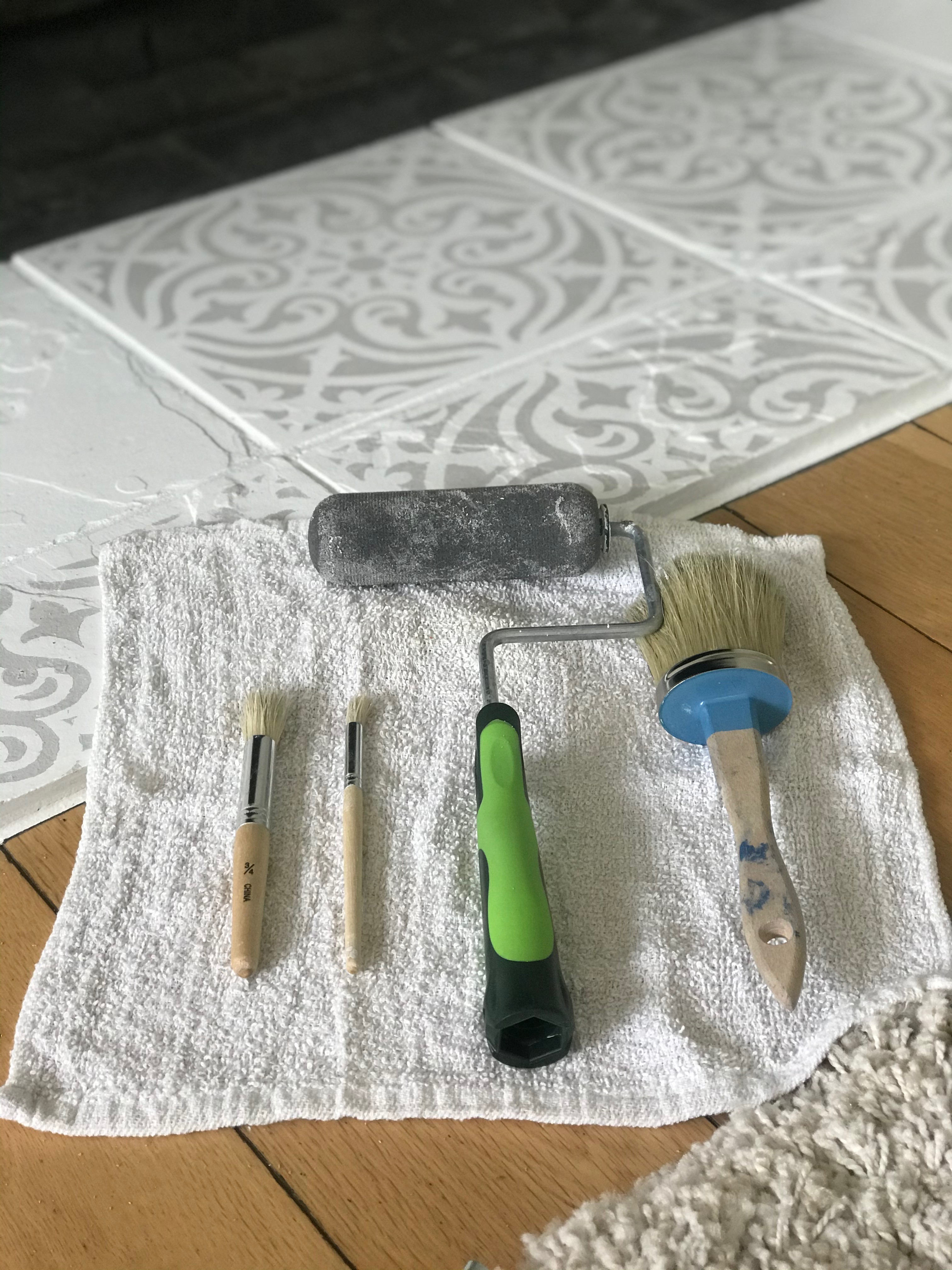 Items needed for a DIY fireplace mantel stencil decoration