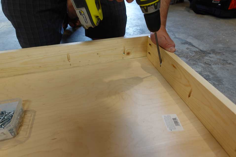 screwing in pocket holes to make cornhole boards