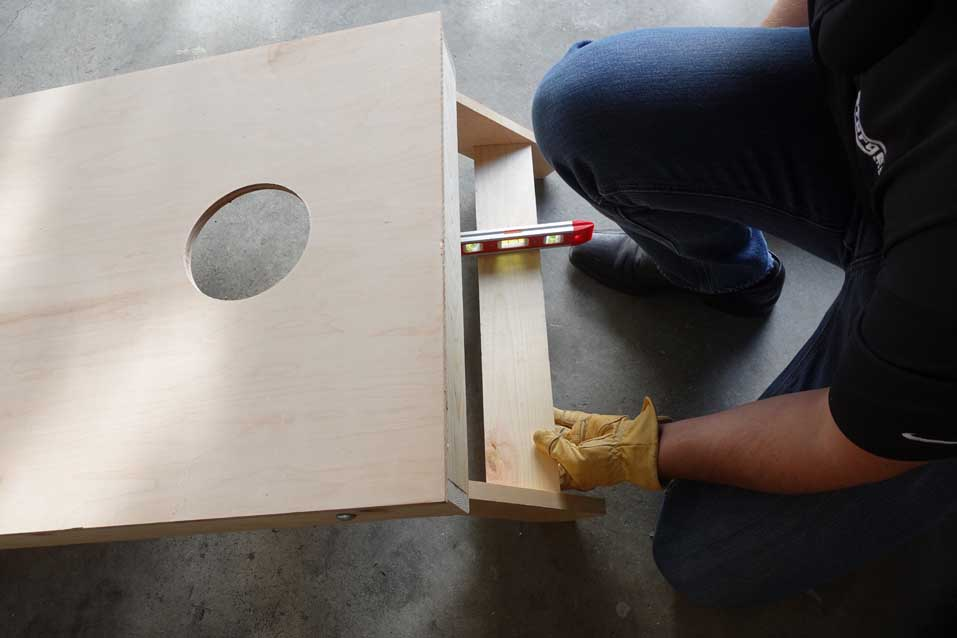 measuring where to put support between legs on cornhole boards