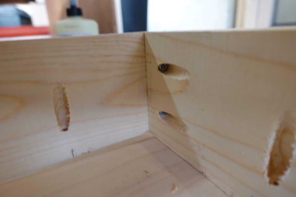 pocket holes in a cornhole board