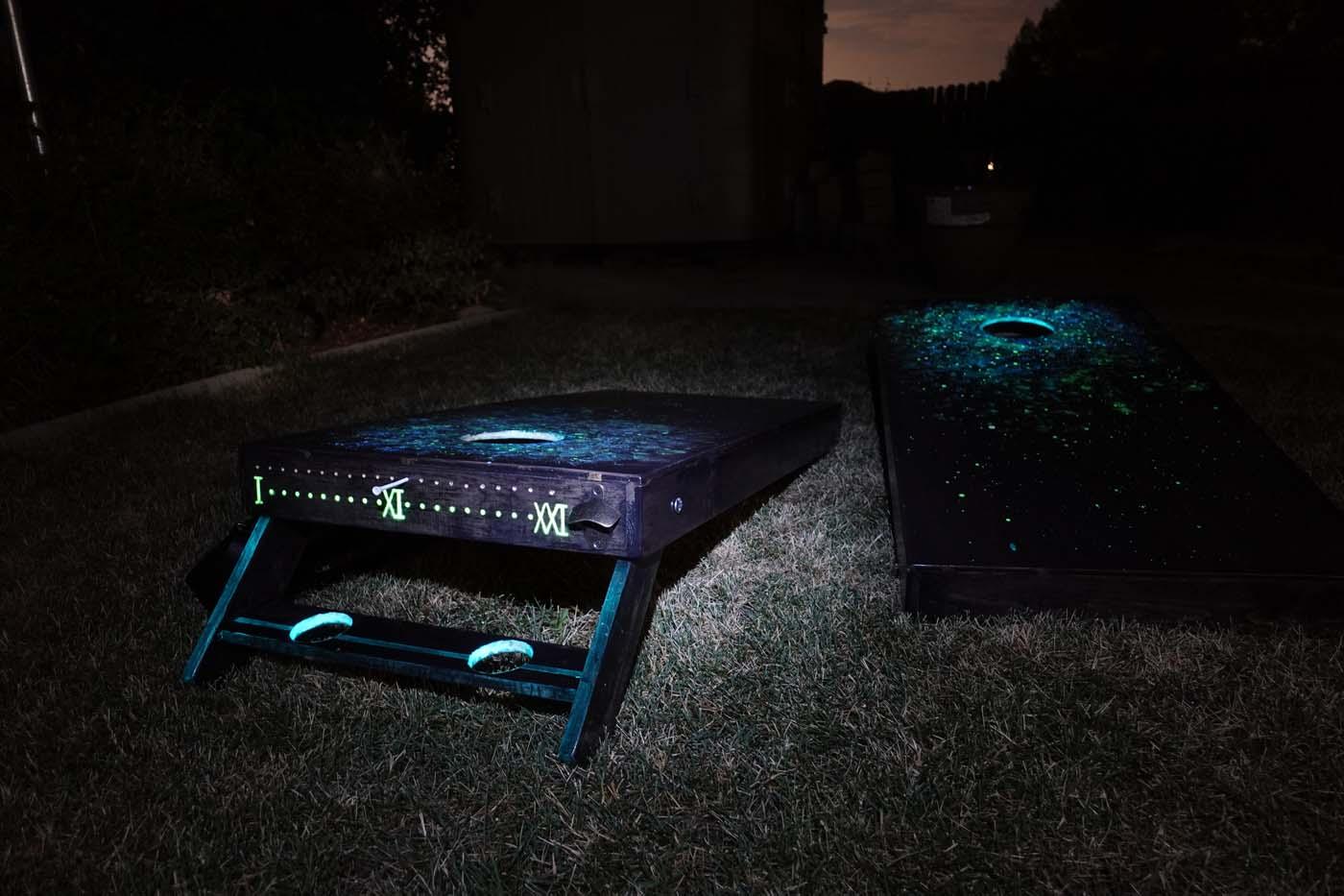 Lansia's galaxy glow-in-the-dark cornhole board with beverage holders