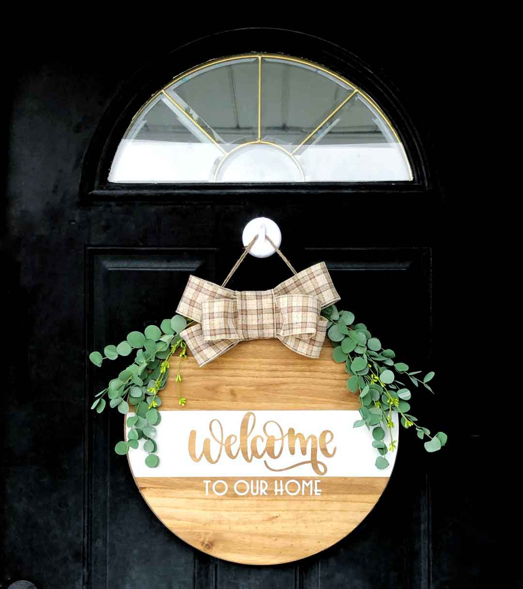 Cricut Iron-On wood round decorated welcome sign