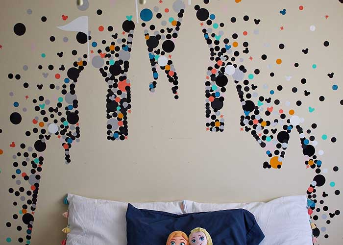Wall decor using vinyl and Cricut cutting machine in the shape of a Disney castle