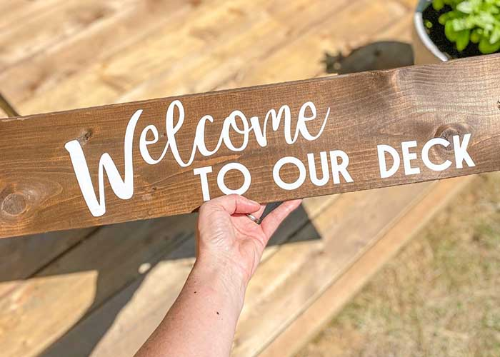 Welcome to our deck sign with Cricut vinyl