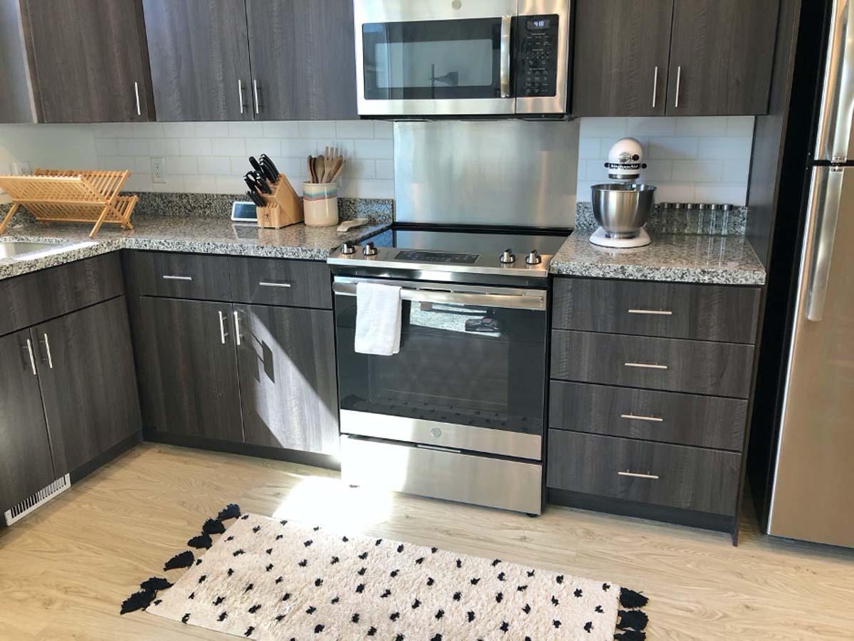 Faux subway tile backsplash in kitchen cut with a Cricut machine