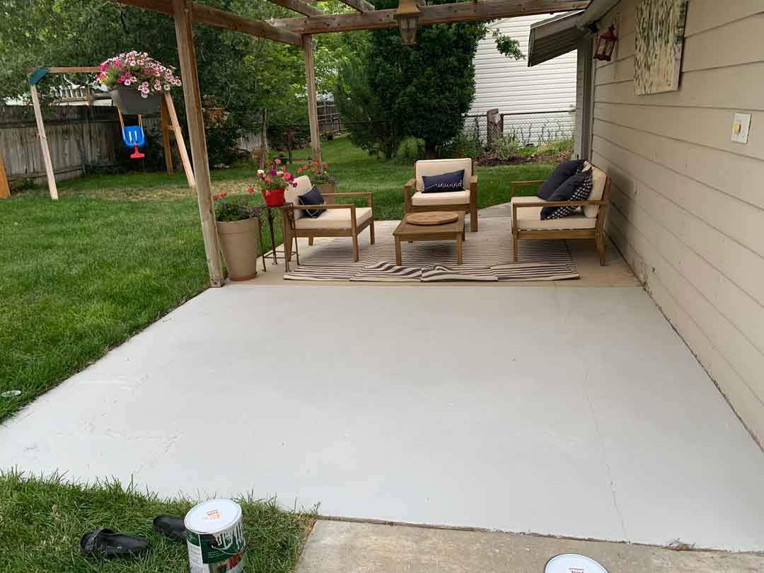 base layer of paint on concrete slab