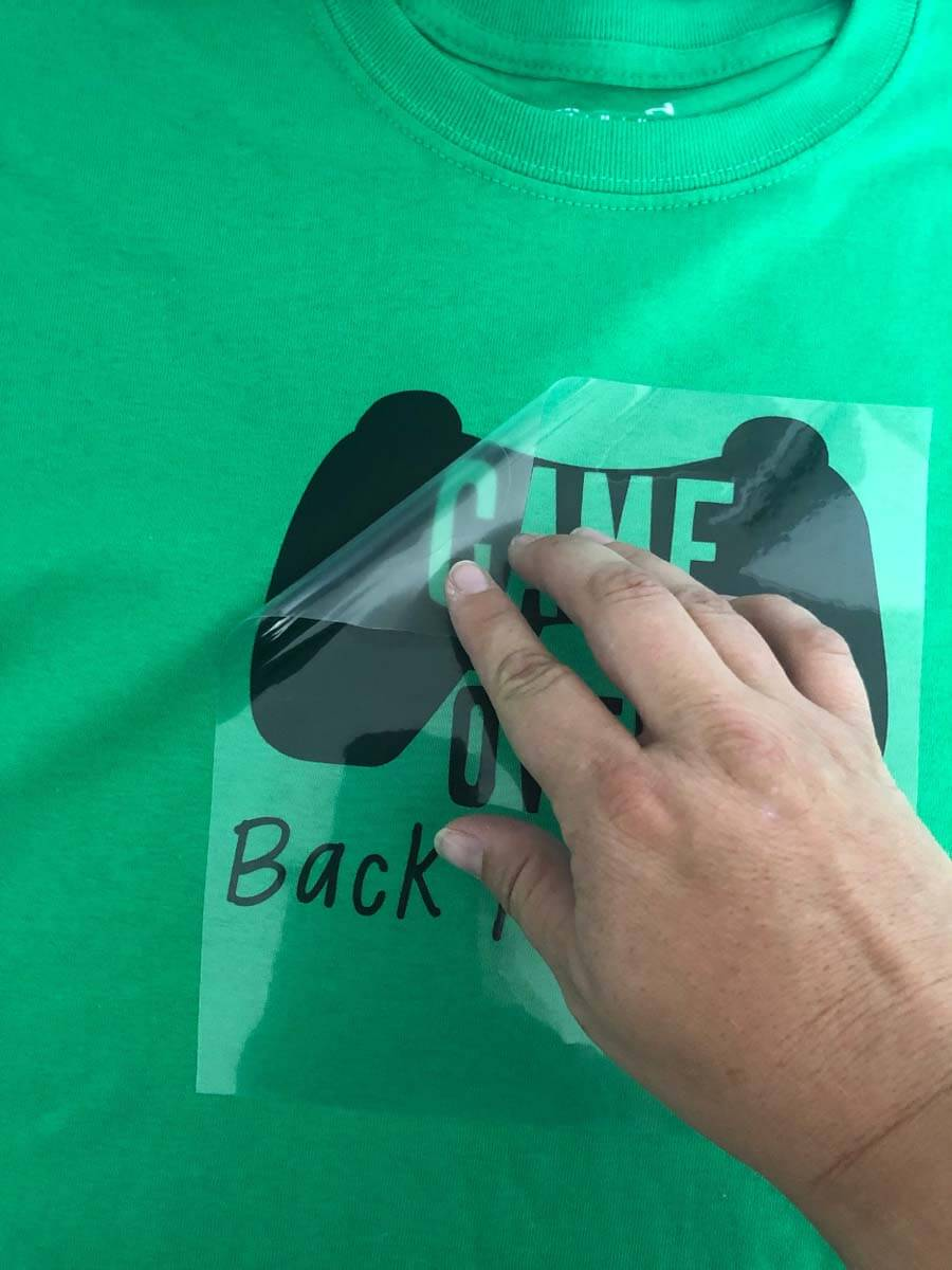 Back-to-School Game Over T-shirt designed peeling off the Cricut Everyday Iron-On backer sheet