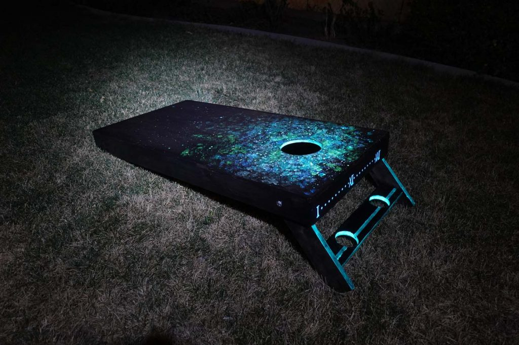 DIY Glow-in-the-dark Cornhole Boards with Galaxy Pattern