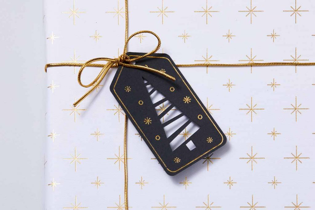 Christmas tree gift tag and wrapping paper with foil effects created with a Cricut and the Cricut Foil Transfer Tool