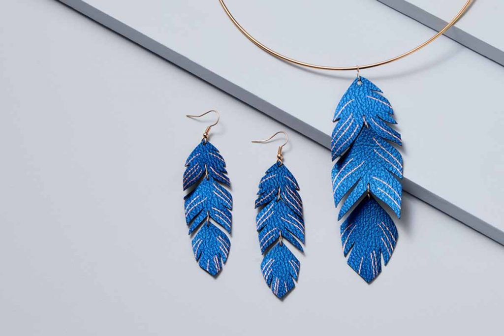 Faux leather feather earrings with foil accents created with a Cricut and the Cricut Foil Transfer Tool