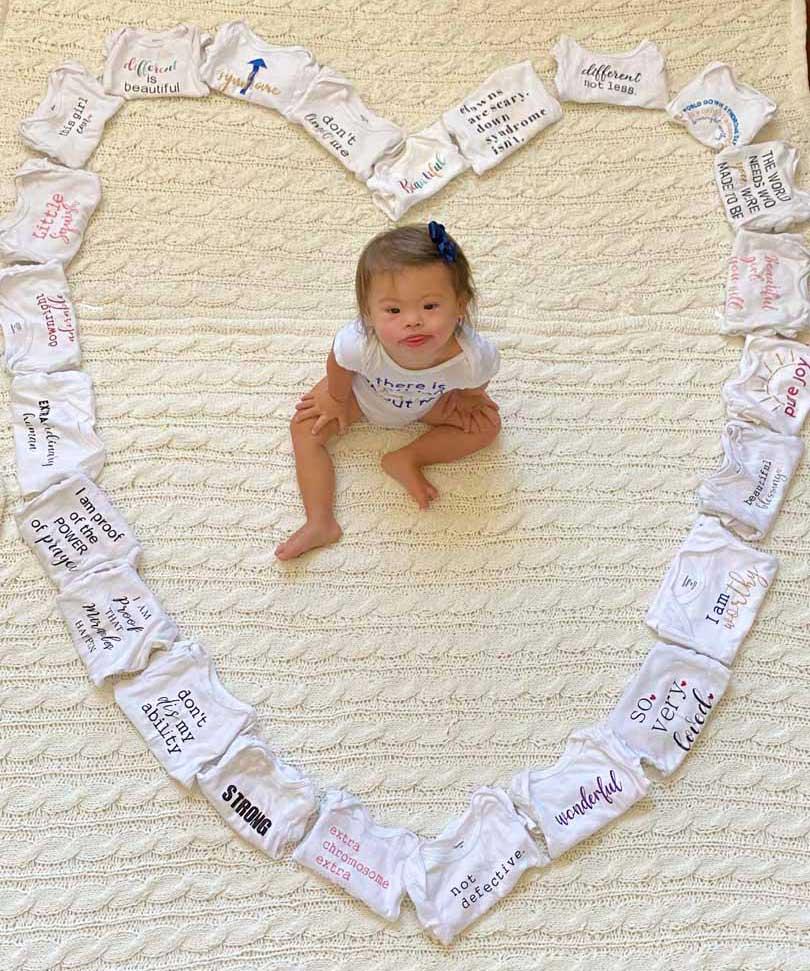 Baby Arabella with heart of onesies