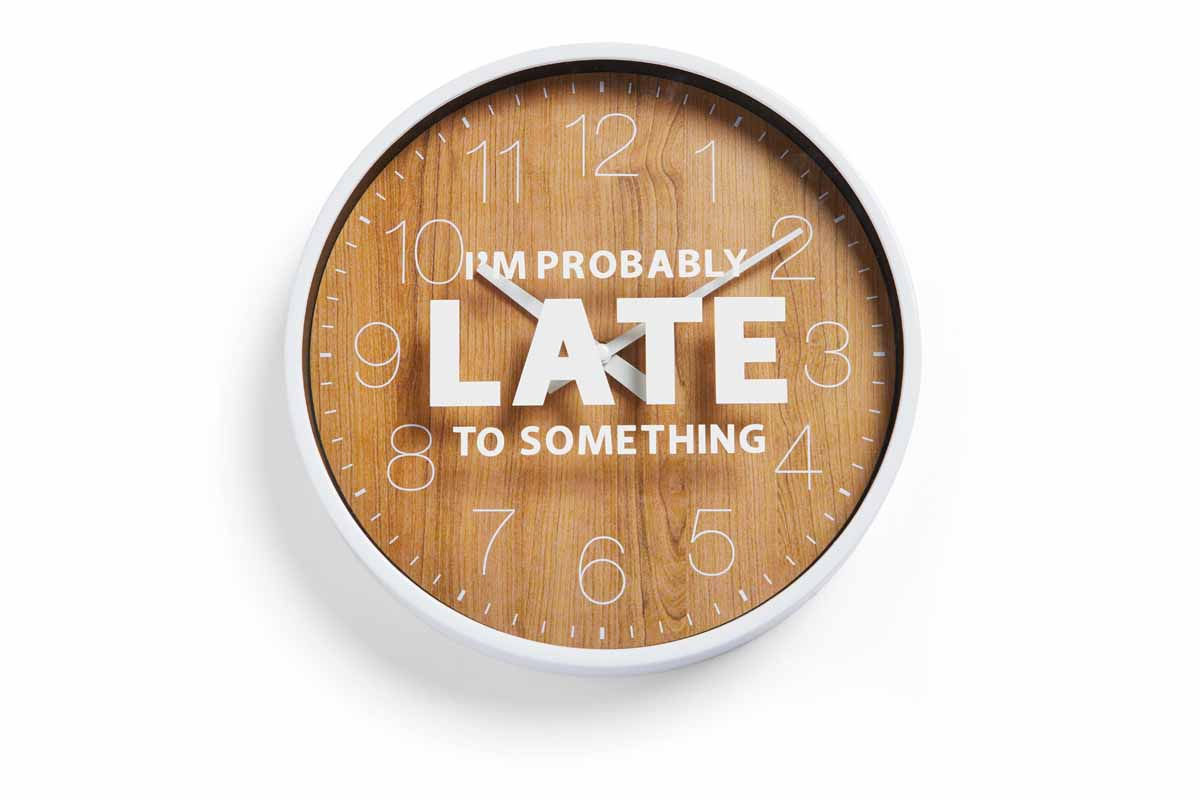 "Clock with vinyl phrase saying, ""I'm probably late to something."""