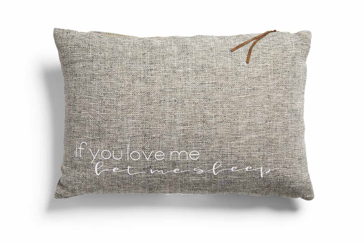 "Pillow with the phrase, ""If you love me, let me sleep."""