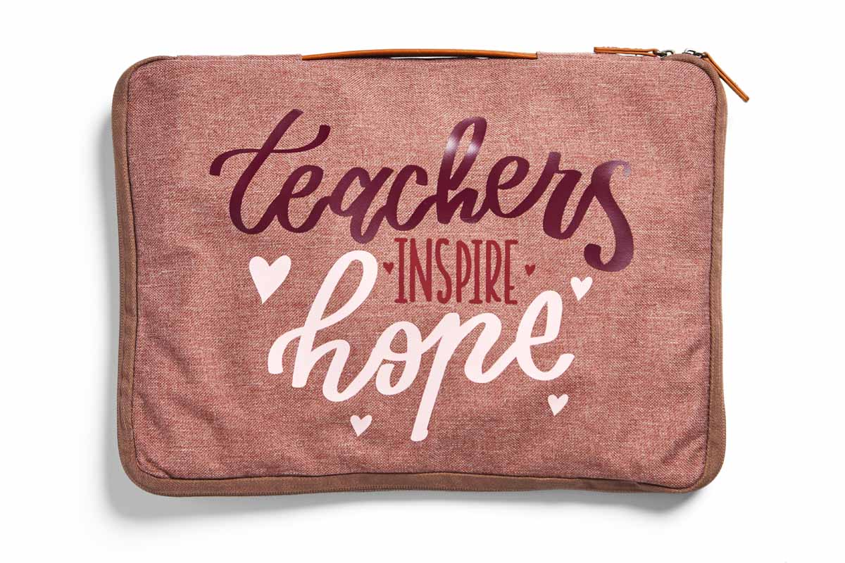 "Laptop for teachers with the phrase, ""Teachers Inspire Hope."""
