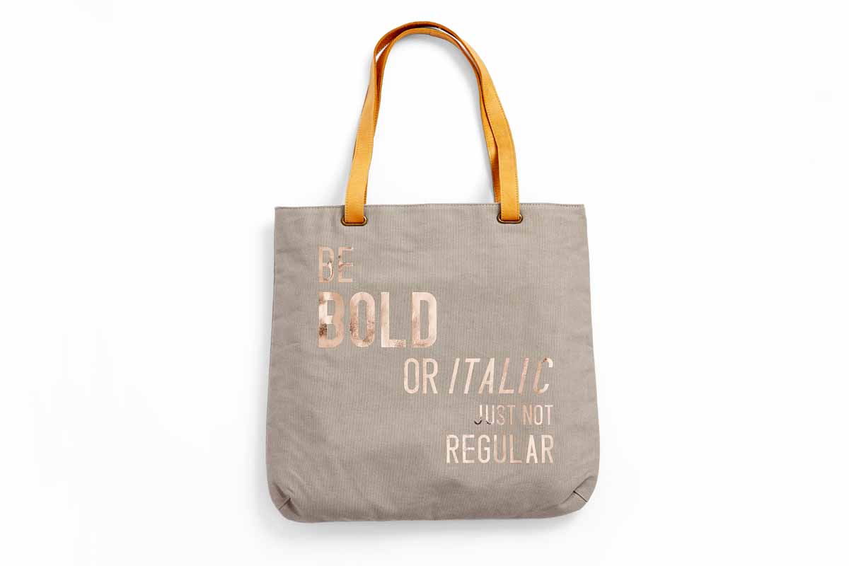 "Custom tote with the phrase, ""Be bold or italic, just not regular,"" on it."