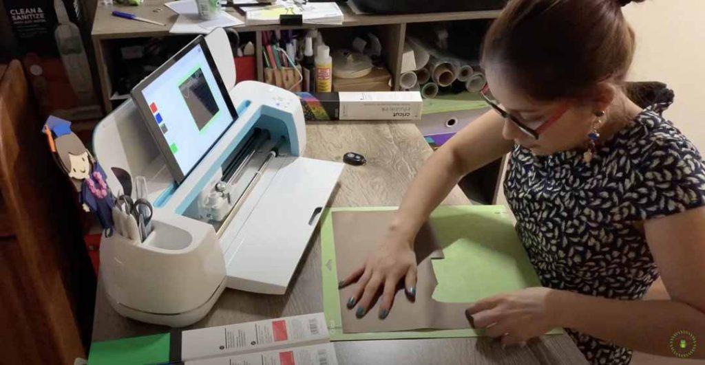 Abigail Carrillo crafting with her Cricut Explore cutting machine