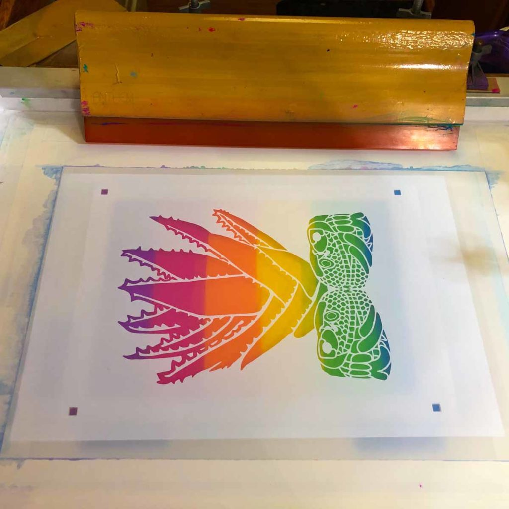 Screen with Cricut vinyl stencil applied before inking from Melanie Cervantes