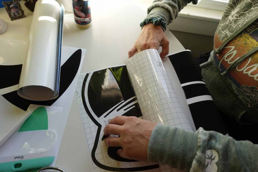 adding transfer tape to a vinyl decal