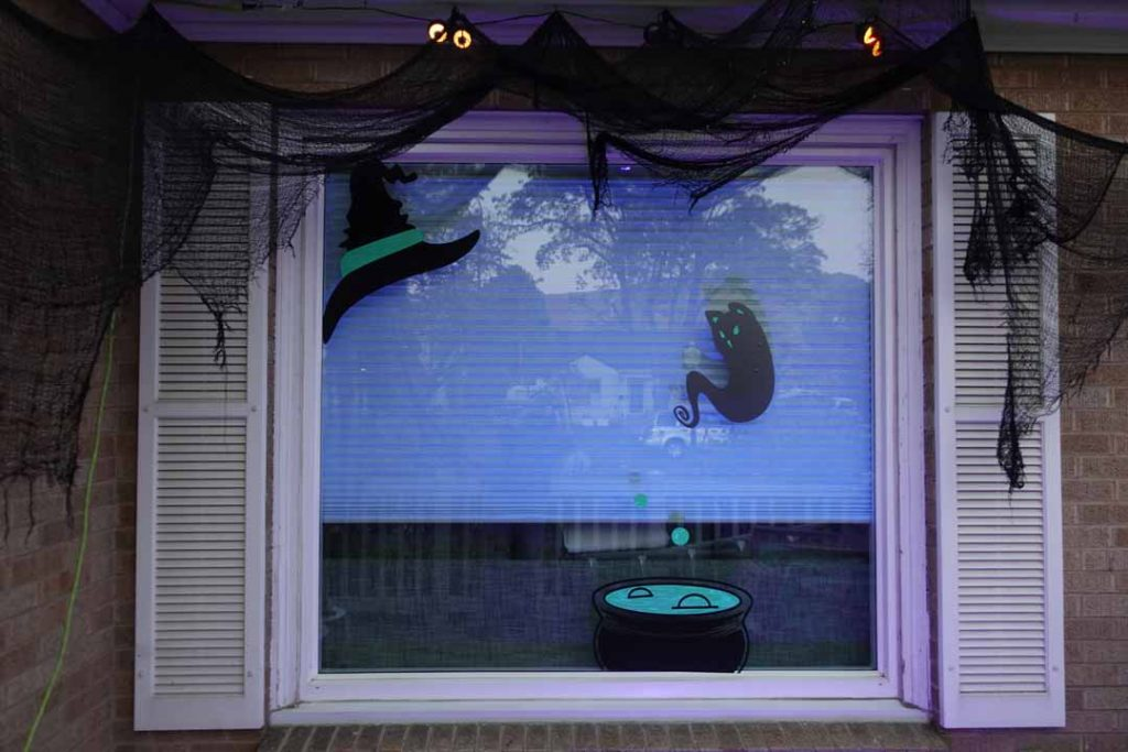 Finished Halloween vinyl silhouettes in window