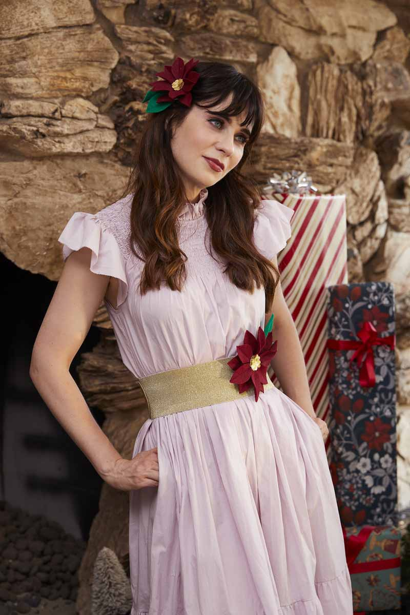 Zooey Deschanel in homemade poinsettia hair clip and belt created with Cricut Maker