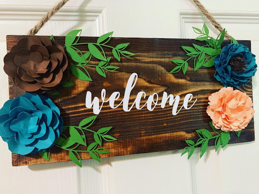 Paper flower wood welcome sign