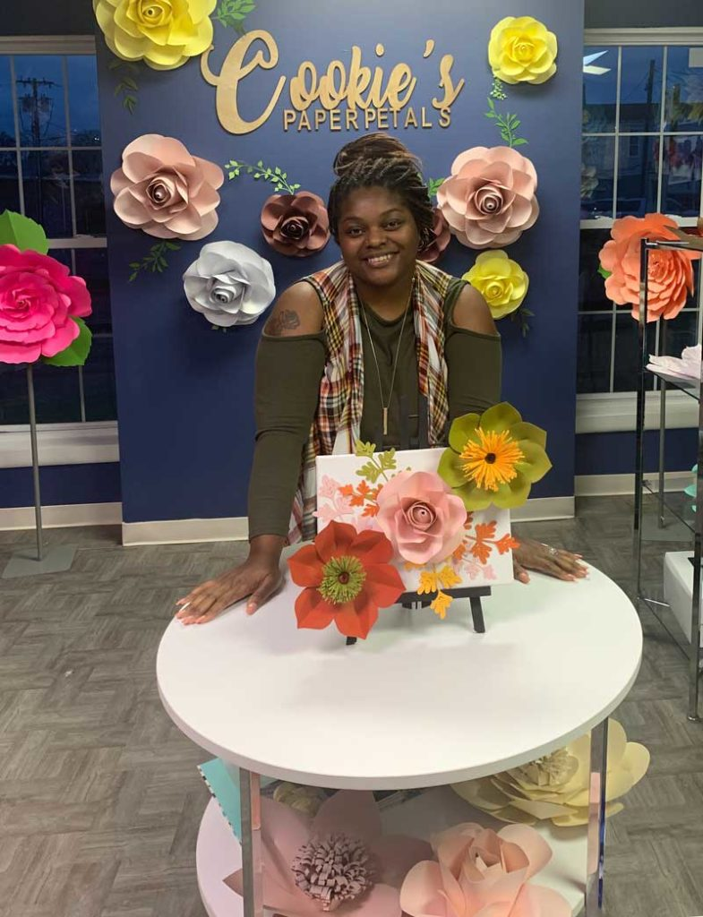 Anastasia Jackson with fall paper flowers