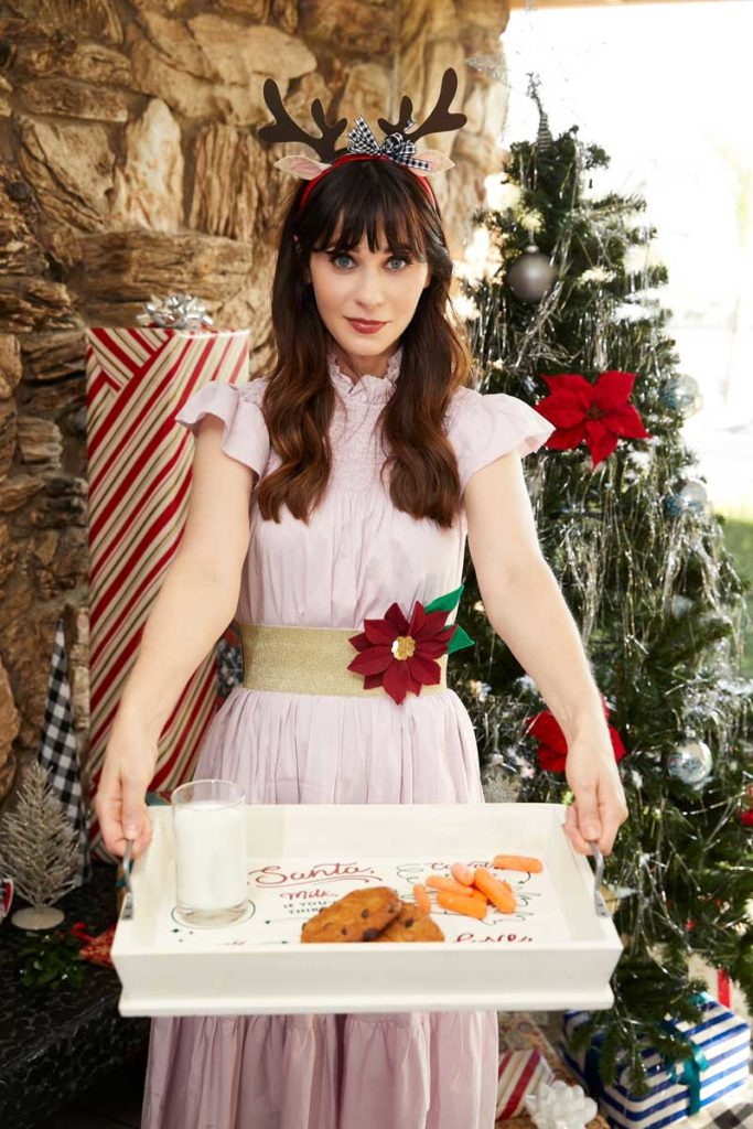 Zooey Deschanel with #CricutMade reindeer antler headband and Santa tray