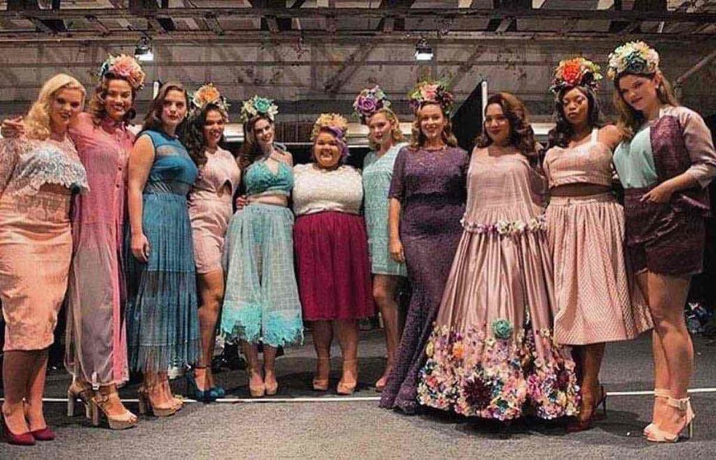 Ashley Nell Tipton with her finale designs and models