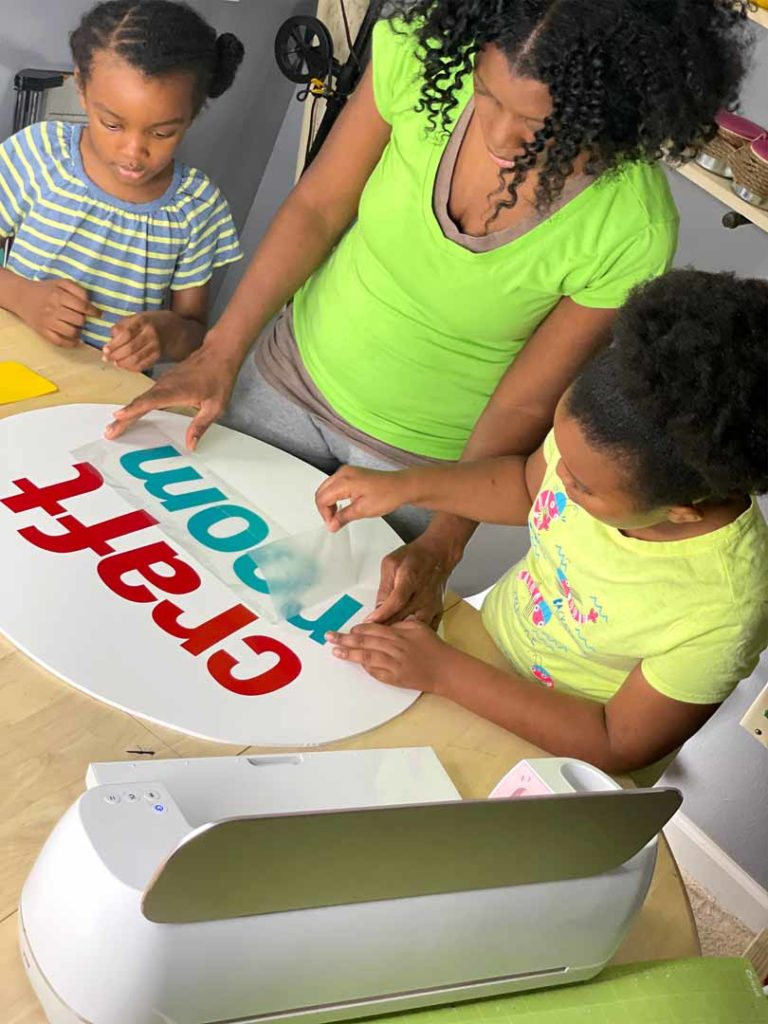 Artist Joey Johnson crafting with her daughters