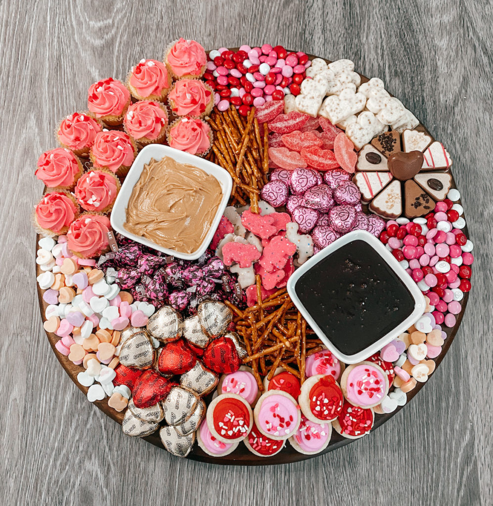 Charcuterie board with cookies and candy