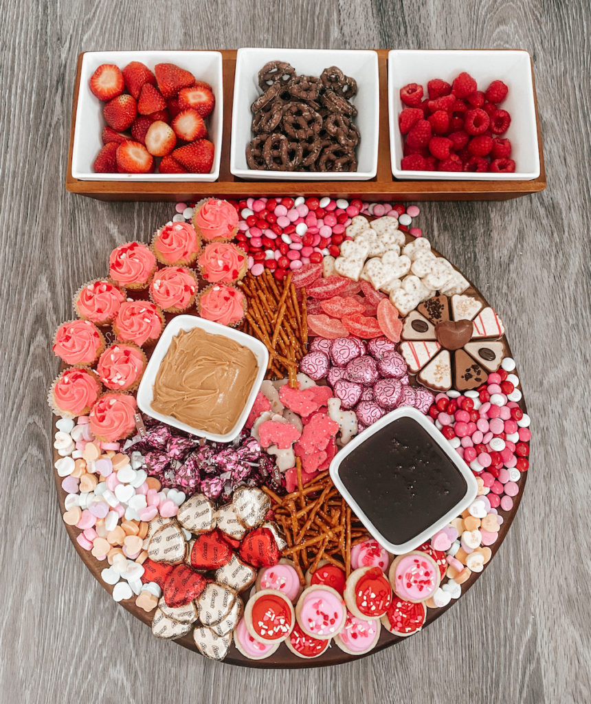 Charcuterie board with chocolates and treats