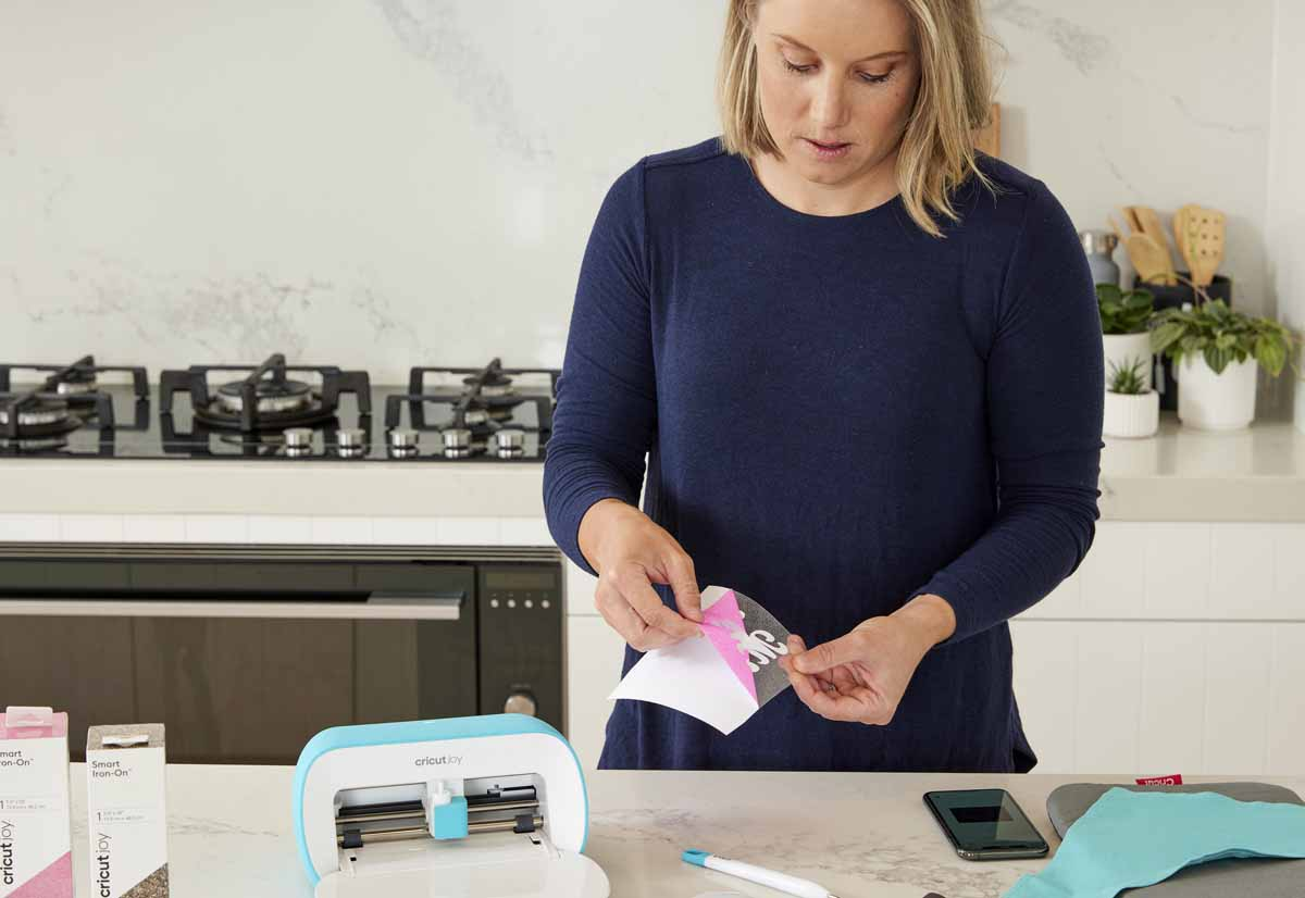 Cricketer Alyssa Healy making bandanas for her dogs with Cricut Joy