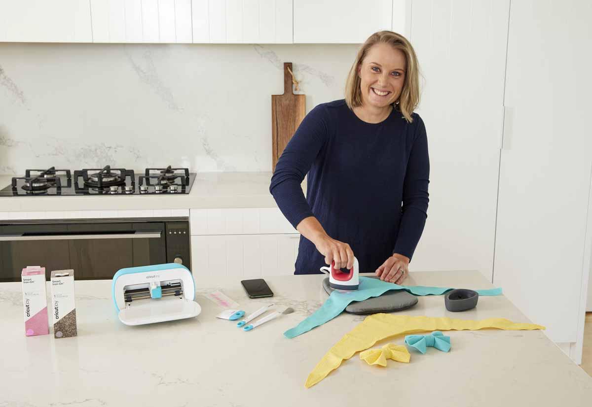 Cricketer Alyssa Healy making bandanas for her dogs with Cricut Joy