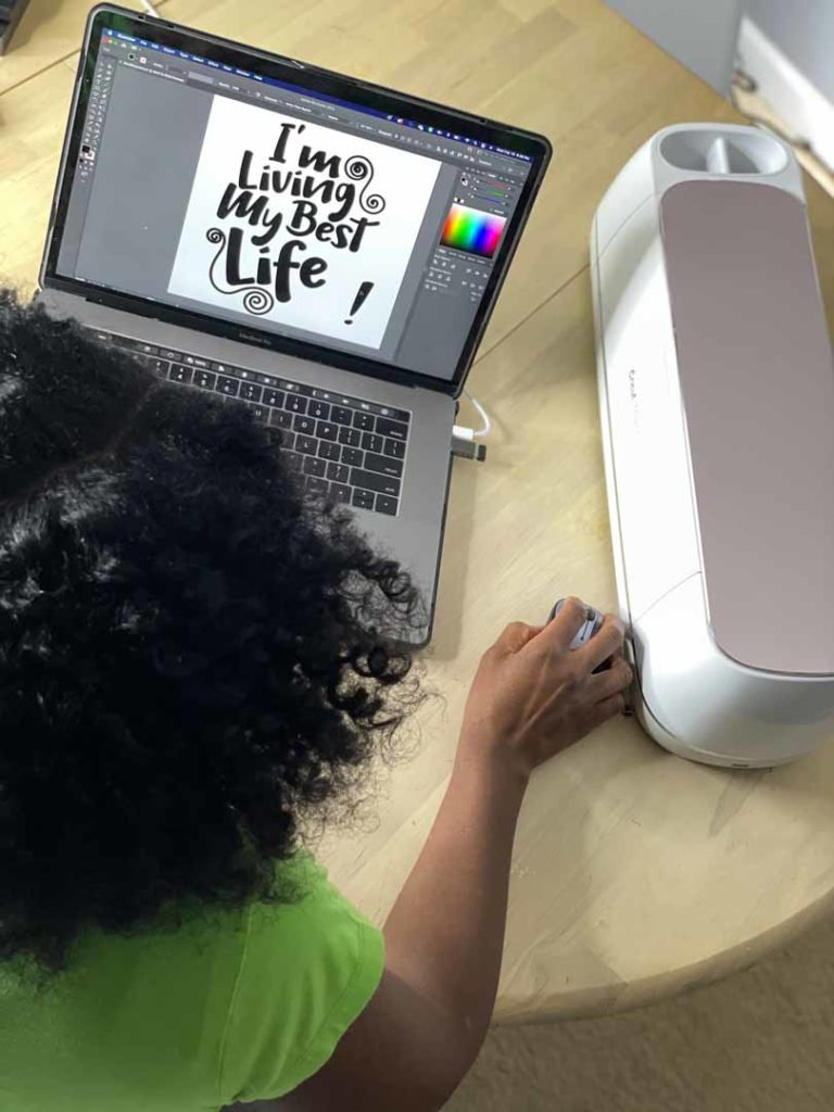 Joey Johnson working with her Cricut Maker