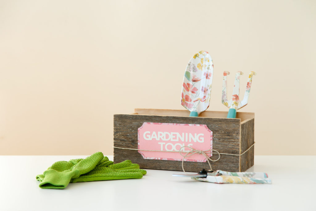 Gardening tools in labeled box