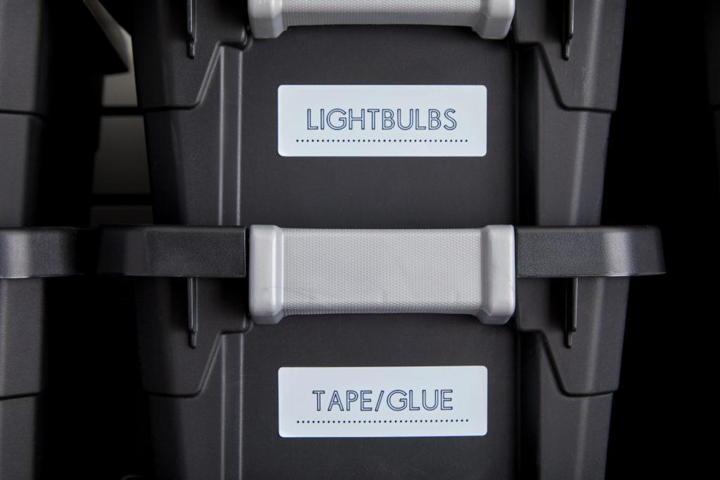 Labels on black storage bins