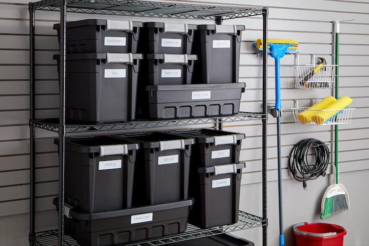 Organized garage with bins on shelves