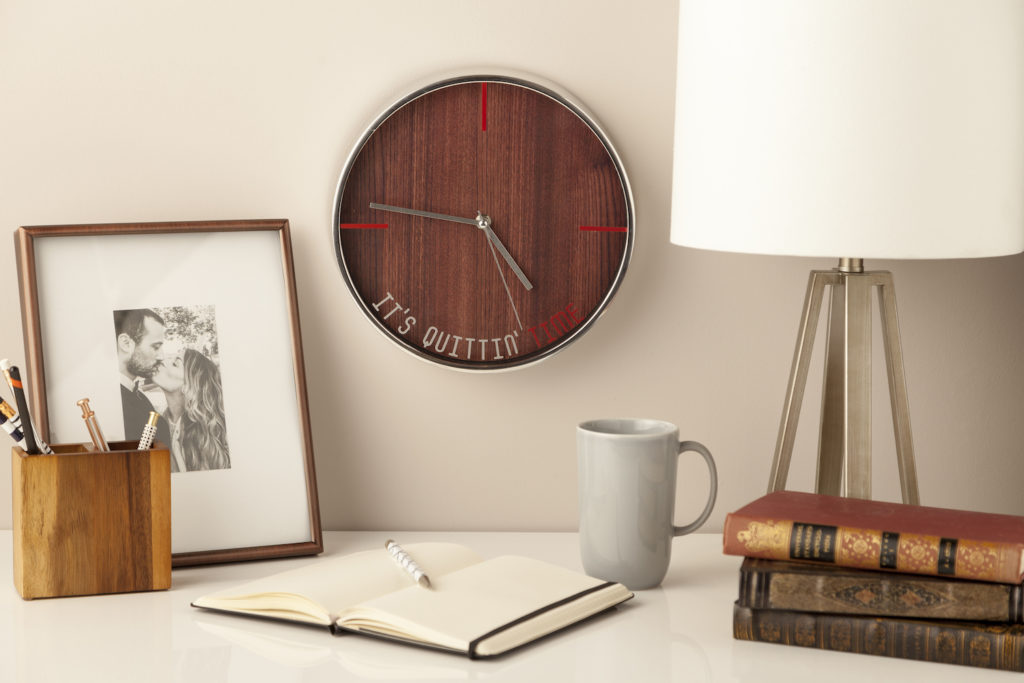 Desk space with clock