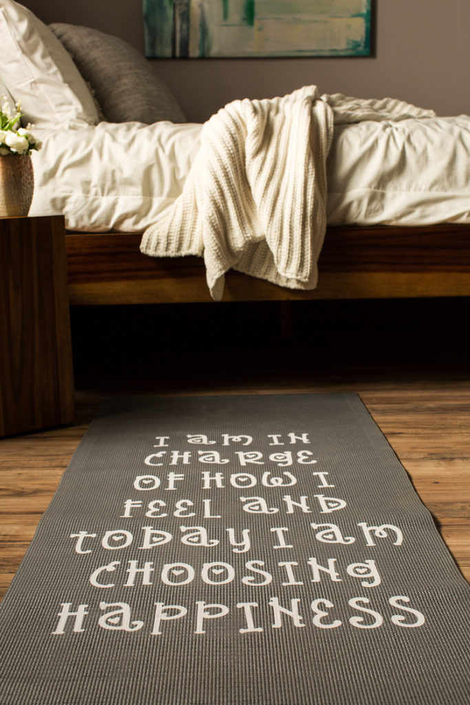 Unrolled yoga mat with words