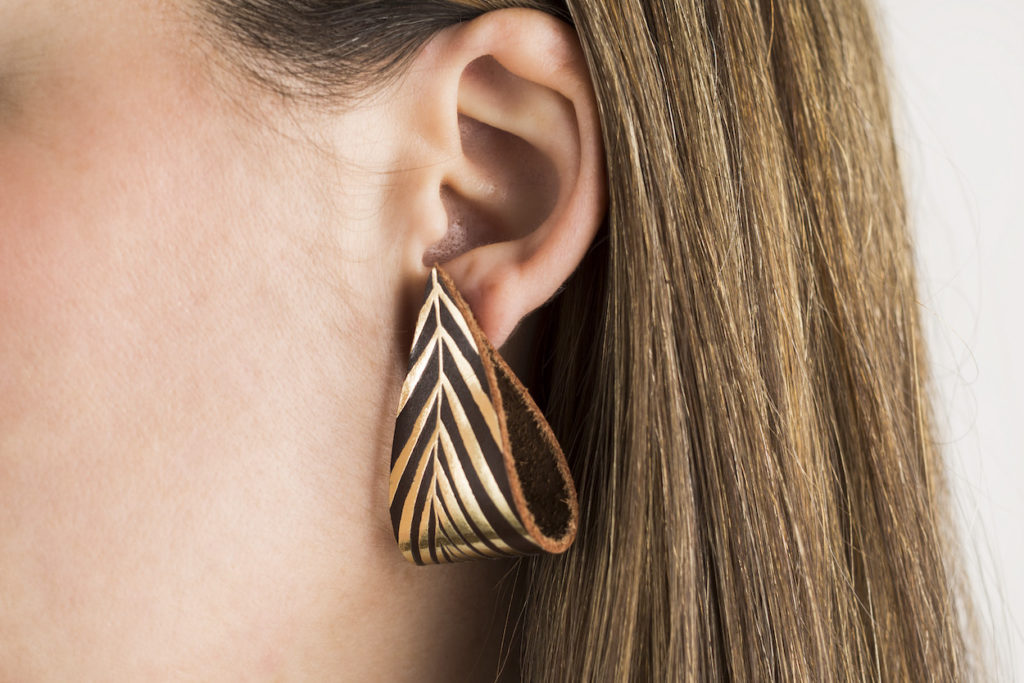 Close-up of handmade leather earring