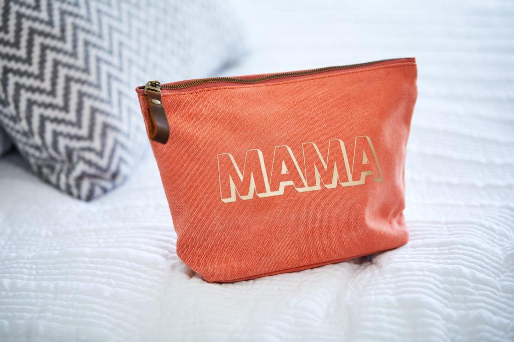 """""""Mama"""" makeup bag on bed"""