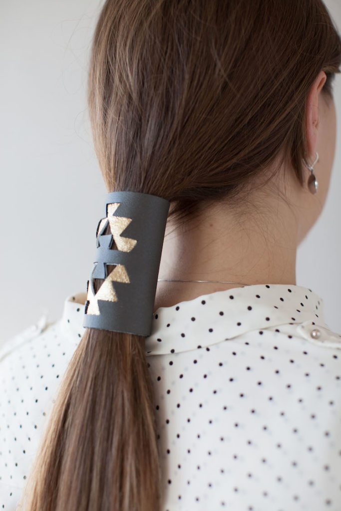 Leather ponytail wrap on woman