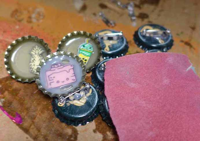 Bottle cap pins with Smart Labels and Smart Paper with sandpaper for texture