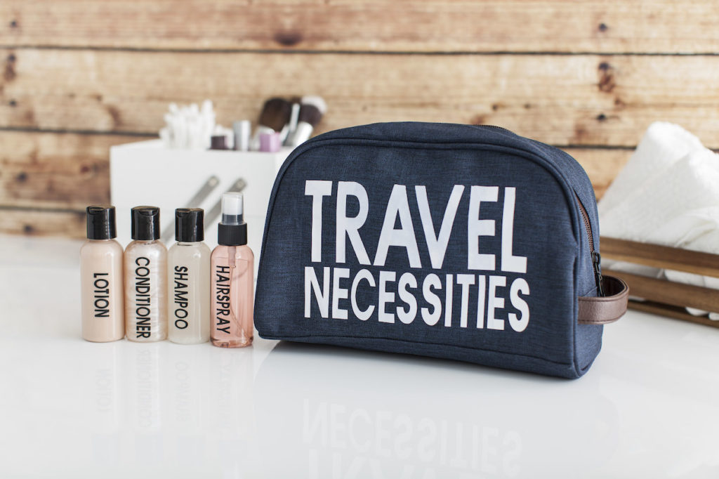 Travel necessities kit with travel-sized bottles